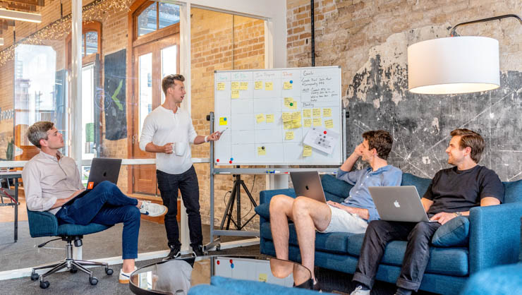 Man giving presentation to co-workers