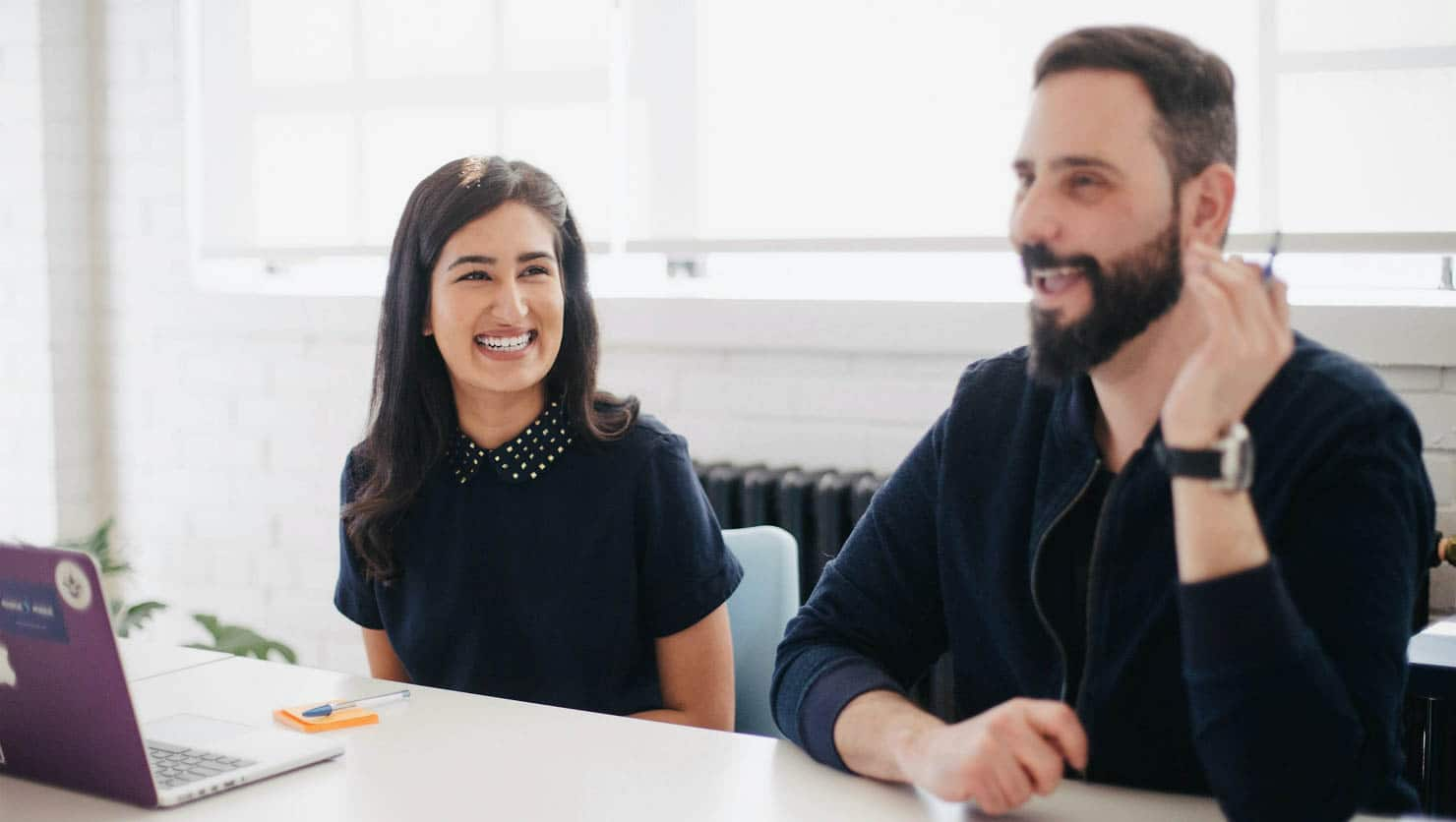 Woman and man smiling at meeting